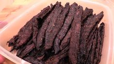 How to smoke beef jerky on the WSM. I show step by step how to prep your WSM, how to control your heat, and how to make the best homemade smoked beef jerky y...