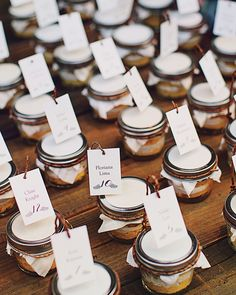 The bride didn't want to stop the dancing for a cake cutting, but the groom loved yellow cake. The compromise at this December wedding? Filling canning jars with slices made from good ol' Betty Crocker mix to create escort cards-turned-favors.