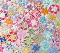 Amazingly beautiful + extraordinarily fussy-cut and hand-pieced hexagon star quilt, made by the MIL of Red Pepper Quilts' Rita.