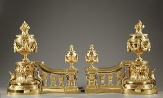 Pair of Louis XVI style gilt bronze andirons, representing fire pots decorated with garlands and flames resting on a baluster. There are typical Louis XVI patterns such as garlands of leaves, architectural balusters and antique fire pots.        Circa :1870