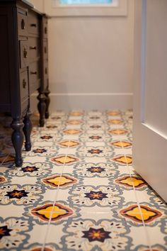 Colorful patterned tile in a small bathroom | Before & After: Megan's Modern & Mexican Tile Small Bathroom Mix | Apartment Therapy