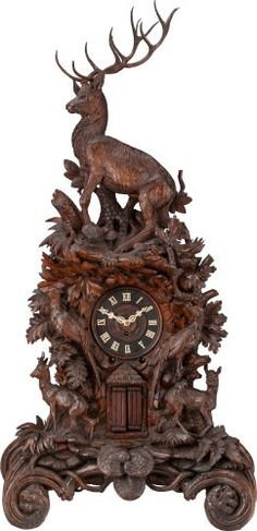A LARGE BLACK FOREST CARVED WOOD AND IVORY MANTLE CLOCK, 19th century -   57-3/4 x 27 x 15 inches (146.7 x 68.6 x 38.1 cm)