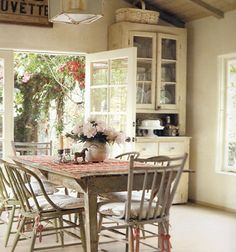 love the open door and old table and super tall hutch and, and, and.