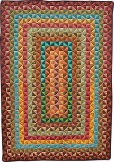 Made up entirely of half square triangles (E. Wolfmeyer Quilts: THE GALLERY: 2006 - 2007)