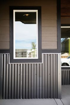 Give your home's exterior a unique, multi-textured appearance with corrugated metal wainscoting. Exterior Siding, Exterior Colors, Exterior Design, Tin Siding, Ranch Exterior, Exterior Stairs, Facade Design, Metal Shop Building, Building A House