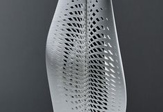Interstice's curves and perforations allow for glimpses of the vase's contents