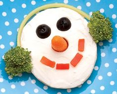Healthy Holiday Snack for Children: Frosty the Bagel     This is half of a bagel with reduced-fat cream cheese spread. The ear muffs are broccoli, carrot for the nose, black olive eyes and red bell pepper slices to make the mouth. The muff connector is a whole wheat pasta noodle.