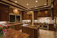 Stunning kitchen in Las Vegas home by Quinn Boesenecker Pinnacle Architectural Studio.