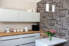 Black cab, Queens Head, Union Jack and Big Ben all featured in Victoria Eggs Airfix London Wallpaper. Graduate Collection available at The Pattern Collective
