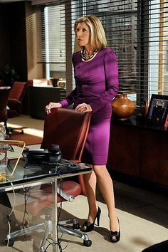 Diane Lockhart in a purple long-sleeve dress and peep toe shoes with bows #thegoodwife The Good Wife fashion by costume designer Daniel Lawson