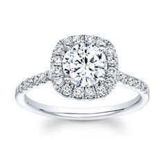 White gold and diamond halo engagement ring
