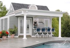 The pool house features a large front porch awning.
