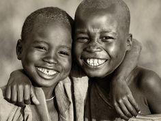 Two young Suri boys in Koka, near Tulgit.  Ethiopian Tribes, Surma, Suri people..
