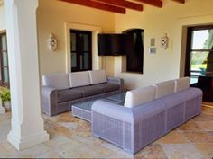 Luxury outdoor foam cushions cut to size and shape and upholstered in water and weather resistant fabric.