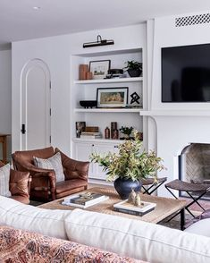 comfortable living room design // fireplace // built in shelves // leather armchair // modern coffee table My Living Room, Living Room Interior, Home And Living, Living Room Decor, Living Spaces, Decor Room, Bedroom Decor, Decoration Inspiration, Interior Design Inspiration