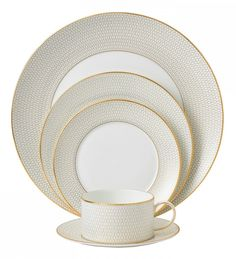 Features: -Set includes 5 piece dinnerware set. -Arris collection. -Material: Fine bone china. Color: -Cream. Style: -Contemporary. Material: -China. Number of Items Included: -5. Set Includes