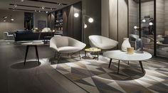 Fauteuil de conversation LENNOX. Fauteuil de salon avec piètement tubulaire en métal finition bronze et revêtement de l'assise et du dossier en tissu ou cuir.