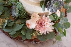 Style Me Pretty featured wedding cake with dalias and succulents by The Butter End Cakery, Santa Monica, CA  Read More: http://www.stylemepretty.com/2013/12/10/malibu-vineyard-wedding/
