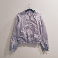 UNIQLO WIDE-COLLAR BOMBER JACKET Padded minimalist nylon bomber jacket from Uniqlo. Great for layering or on its own. Worn twice. All garments come from a pet-loving home. UNIQLO Jackets & Coats