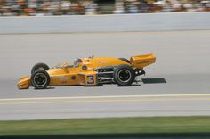 News Photo : Johnny Rutherford in action during race at...