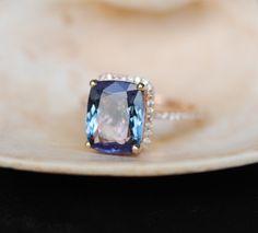 Tanzanite Ring. Rose Gold Engagement Ring Lavender Mint Tanzanite emerald cut halo engagement ring 14k rose gold. by EidelPrecious on Etsy https://www.etsy.com/listing/236521356/tanzanite-ring-rose-gold-engagement-ring