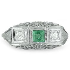 The Touchstone Ring from Brilliant Earth  In this sensational white gold Edwardian ring, a square step cut natural emerald and two old mine cut diamond accents are framed by milgrained geometric details. Intricate latticework in the gallery finishes this fantastic ring (approx. 0.10 total carat weight).