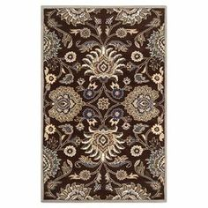 "Evocative of elegant salons, this hand-tufted wool rug showcases a traditional floral motif for a touch of timeless style.    Product: RugConstruction Material: 100% WoolColor: Dark chocolate Features: 0.625"" Pile heightHand-tufted Note: Please be aware that actual colors may vary from those shown on your screen. Accent rugs may also not show the entire pattern that the corresponding area rugs have.Cleaning and Care: Vacuum regularly with non-beater attachment and blot stains ..."