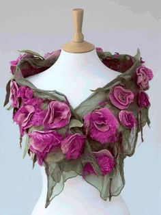 Felted flowers on a sheer fabric shawl.
