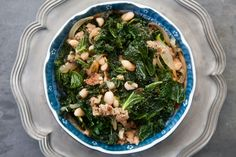 Kale with Sausage and White Beans Recipe Main Dishes with olive oil, sweet italian sausage, onion, large garlic cloves, kale, chicken stock, white beans, salt