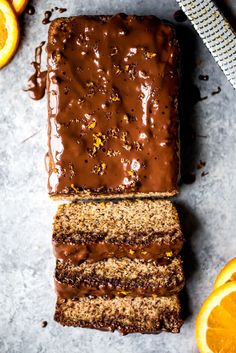Gluten free paleo orange bread kissed and infused with fresh orange juice & zest, then covered with dark chocolate for the ultimate treat. This bread will blow you away by how good it is.