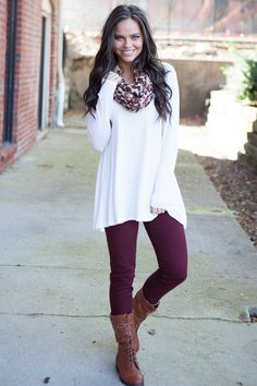 Like the simplicity and style of the top and scarf paired with boots, however the colors would need to work for me.