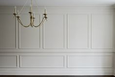 white trimmed out walls. one color. no contrast = taking taste to the next level.