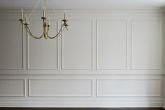 pale grey mouldings & chandelier