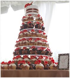 A Wedding Cupcake Tower with a single tiered Wedding Cake on top.