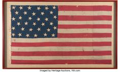 """National Colors from the Battle of Antietam.  According to family lore, after the Battle of Antietam, General McClellan and his troops were riding down the main street in Sharpsburg when McClellan directed that the flag be given to a local resident, Mr. Hoffmaster, saying """"Here is something to remember us by"""". The flag remained in the Hoffmaster family for over 90 years.   It has seventeen bullet holes and considerable blood stains, concentrated along the canvas hoist."""