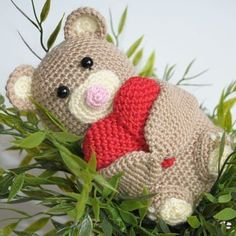 Use this step-by-step amigurumi pattern to create a soft crochet teddy bear holding a heart. Make someone's day with the little cute gift!