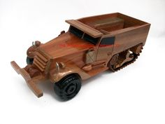 """A beautiful hand carved desktop model of the American Half Track. The model has been carved from solid mahogany. The model comes boxed and requires no assembly. Size H 4"""", L 12"""", Width 4.5"""". Visit our website at thewoodenmodelcompany.co.uk to view the full range of our models."""