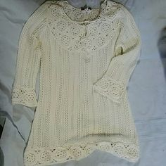 Brand new crocheted sweater Never worn. Clean, smoke free. Adorable, great over cami. One of friend's tops. It fits more like a medium on the smaller side(small-medium?), compared it with tops I own. Color is not a pink cream, think winter white/ivory cream. Dress Barn Tops Tees - Long Sleeve