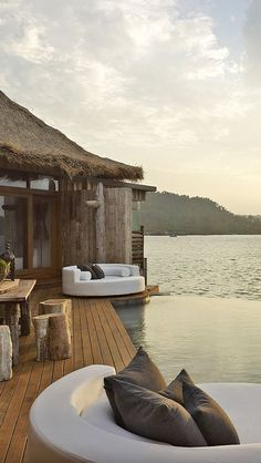 Song Saa private island resort - A beautiful, untouched paradise. Walk among old-growth rainforest, watch dazzling reef fish swim under your villa or see rare hornbills land on your balcony.