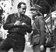 Bob Hope signs an autograph for a member of the Motor Transport Corps (MTC) outside the Savoy Theatre, London, 1945 ~
