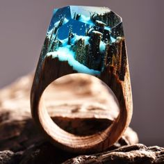 These miniature forest rings are created by Vancouver-based company Secret Wood. According to the brand, they use jewelry resin and wood to turn microscopic natural worlds into wearable art. | These Rings Have Tiny Forests Inside Of Them And They're Enchanting AF