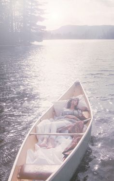 afternoon naps in a canoe <3 Bring the bedding outside in different relaxing places...the boat, a tree, etc.