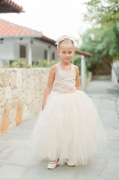 Sweet flower girl in tulle: Beachy lace wedding dress: http://www.stylemepretty.com/destination-weddings/2015/11/21/elegant-white-wedding-in-greece-2/   Photography: Peter & Veronika - http://peterandveronika.com/language/en/