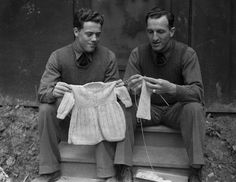 """22 Jun 1942, Northern Ireland, UK --- It may seem a bit unusual for soldiers to be knitting on """"tiny garments,"""" but it does help to pass the time, and these US soldiers stationed somewhere in Northern Ireland, Corporal Robert Cozad, (left) of Red Oak, Iowa, and Private Manny Hamburger, of Des Moines, Iowa, find it a particularly useful hobby for their off duty hours. The boys are good, too! --- Image by � Bettmann/CORBIS"""