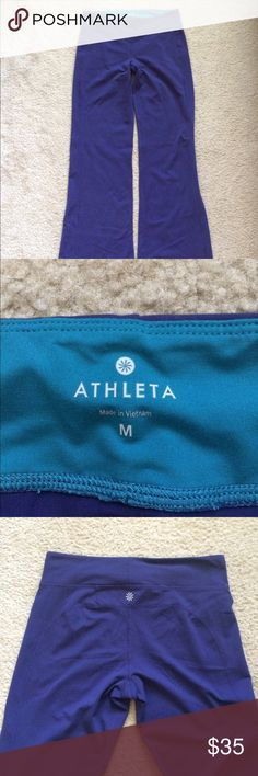"Athleta Purple Workout Athletic Yoga Pant M This is a good pair of Athleta purple workout yoga pants.  It has a teal inside as part of the band. It is a size medium. It is in great condition. Inseam is 30.5"" No rips stains or tears. Comes from a smoke free home. Athleta Pants Boot Cut & Flare"