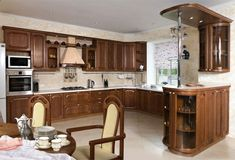 u-form küche Küchensystem aus Nussbaumholz