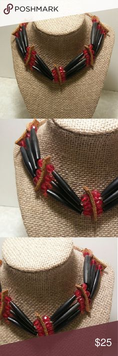 Genuine Native American leather & shell choker Steal any show in this handmade work of wearable art. The long brown beads are a type of shell, and they are mounted on a sturdy leather framework. The red beads really make this necklace pop!  Adjustable length. Artisan Jewelry Necklaces
