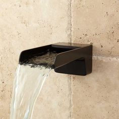 The Jaxson Waterfall Tub Spout delivers a beautiful sight as water cascades into your bathtub Jaxson Waterfall Tub Spout In Black Signature Hardware Small Shower Remodel, Fiberglass Shower, Waterfall Faucet, Small Showers, Modern Shower, Bathroom Faucets, Wall Faucet, Sink Taps, Bathroom Hardware