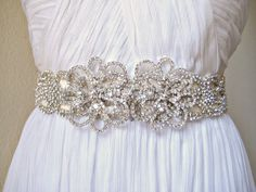 CRYSTAL FLOWER. cut out beaded crystal sash with crystal flower jewel adornment.