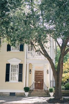 yellow and blue southern style dream house in Charleston South Carolina